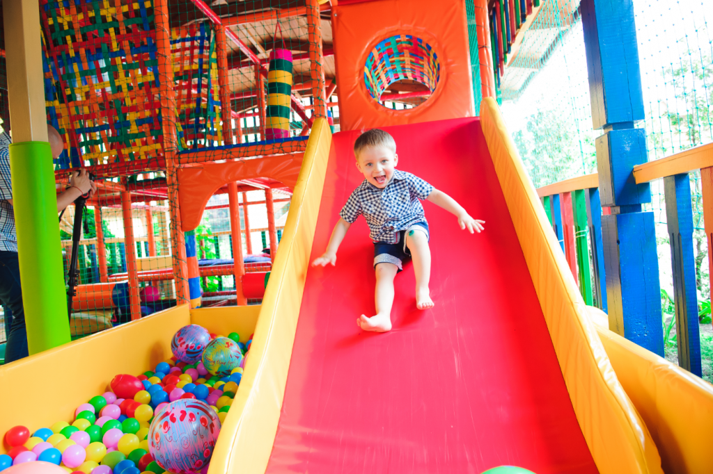 A child sliding down a slide