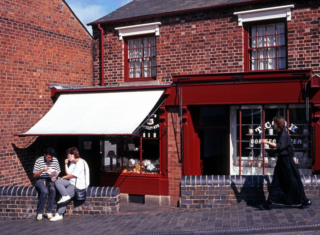 2 people eating outside of the Black Country Museum