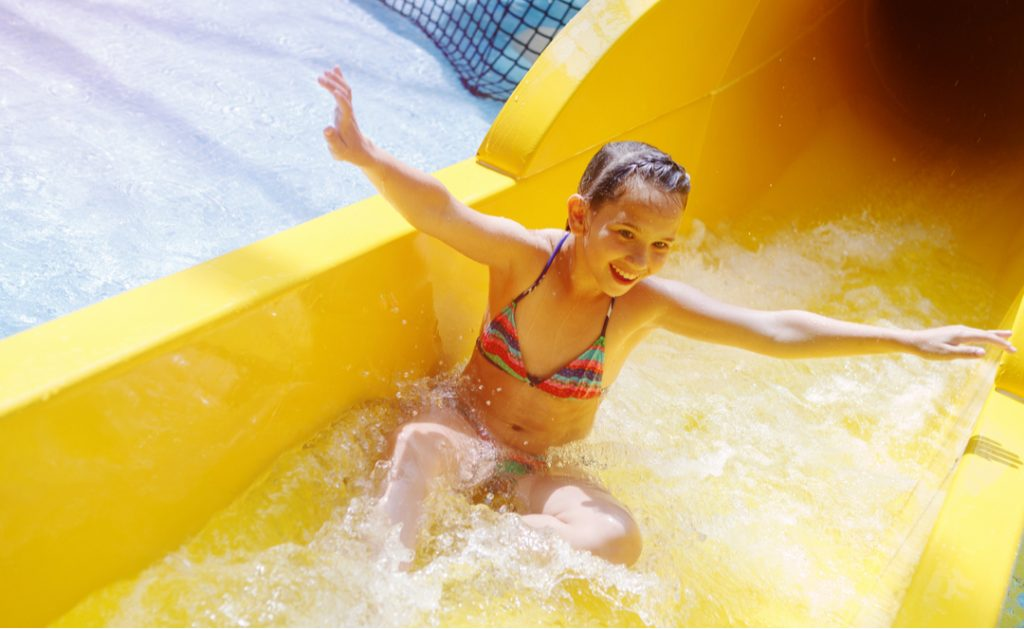 A small girl on a water slide