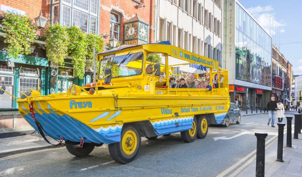Viking splash tours yellow aquatic vehicle driving through Dublin