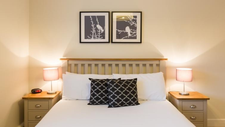 Beautiful bedroom with art on the walls