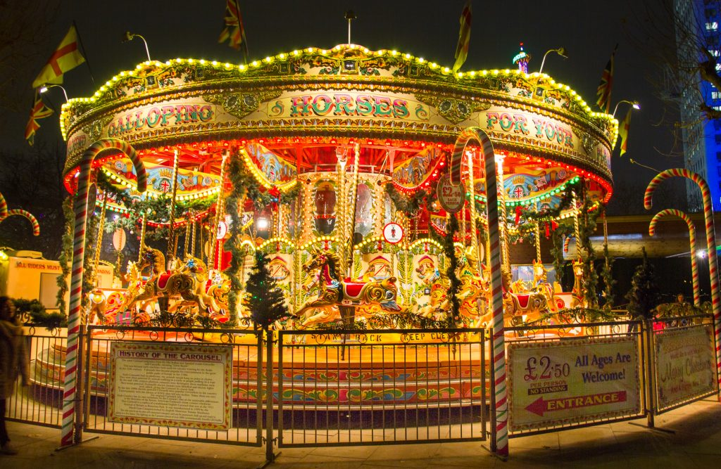 A fairground ride all lit up at night