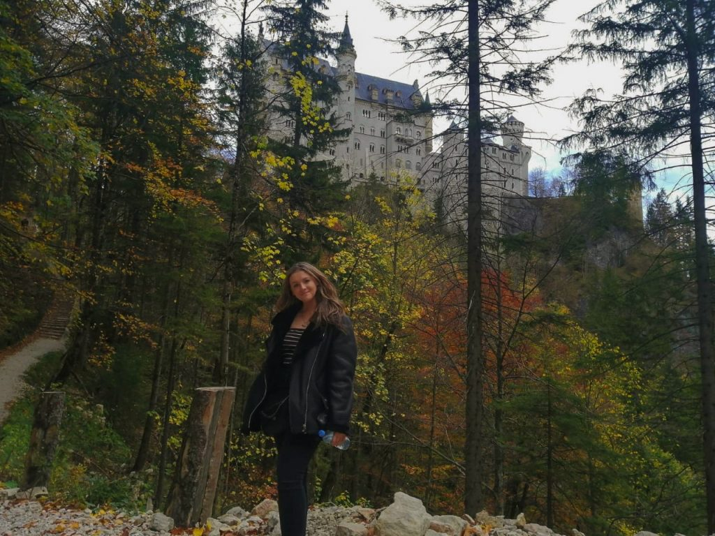 Belle in front of the Castle on a hiking path