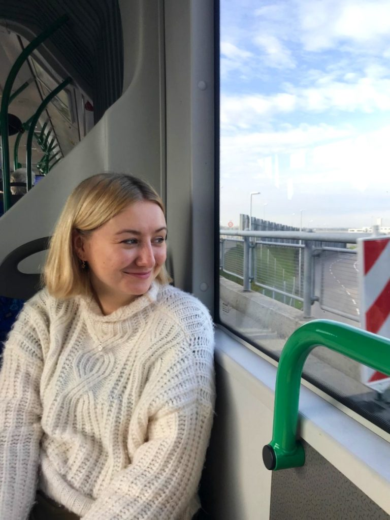 A image of Claire looking out the window of the train as we head into the centre of the city.