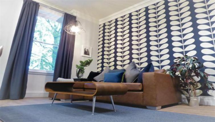 Claremont Apartments Living room image with a focus wall of blue and white