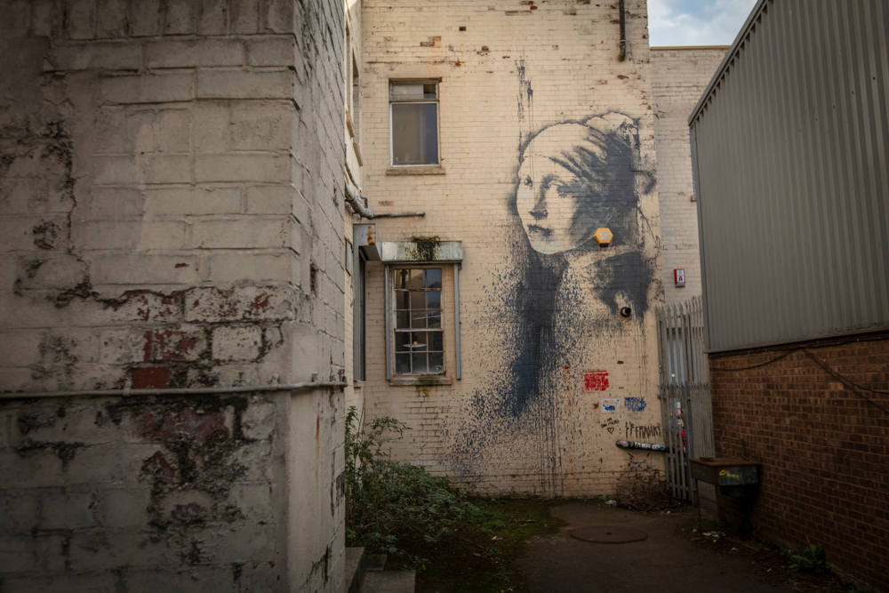 The Girl with a Pierced Eardrum , by Banksy,Bristol
