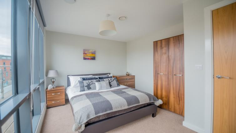 East Point Apartments  Large bedroom with comfortable bed in the centre