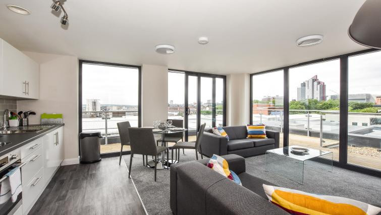 Victoria House Penthouse Open plan living room and kitchen with view onto the balcony
