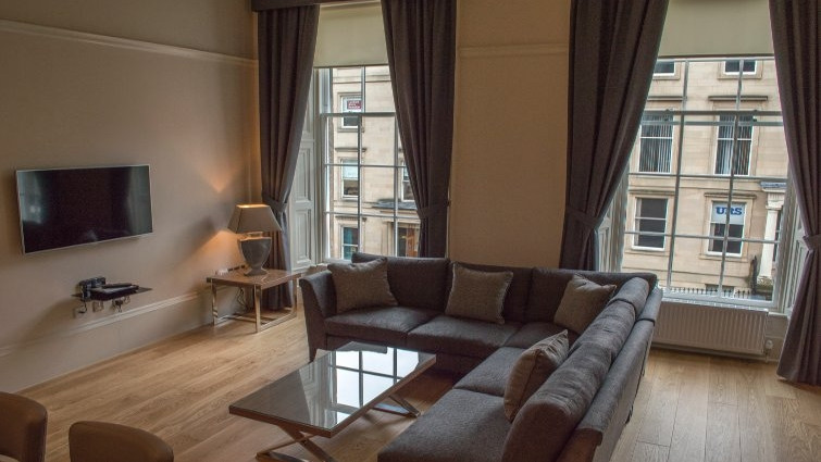 Large windows and living area at Blythswood Apartments Glasgow