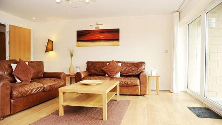 Bright living area at Century Wharf Apartments in Cardiff.