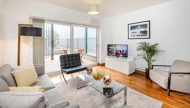 Flamsteed Duplex Apartment living room with patio door
