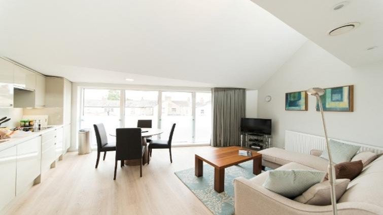 Bright and airy living dining area at Nelson Court Apartments in Cambridge