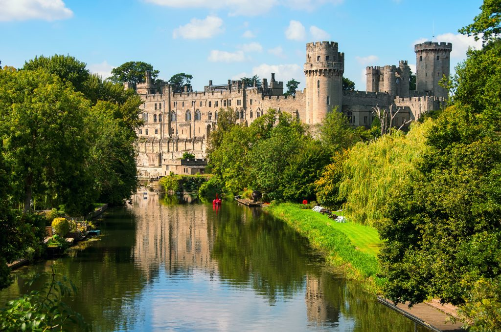 A view of Warwick Castle during summer.