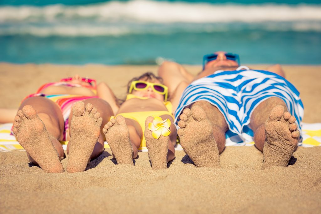 Family sunbathing on a beach