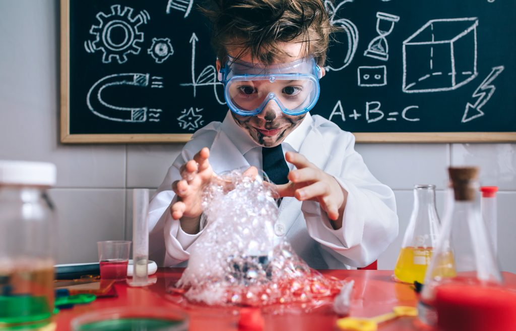A child playing with science and created bubbles