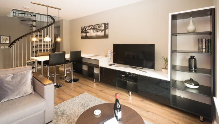 Fitzhamon Apartments with ig living room and stairs for night out in Cardiff