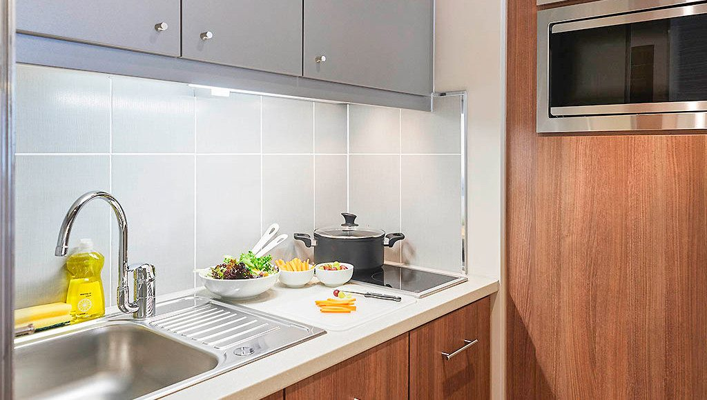 Clean and open kitchen with welcome package on the side