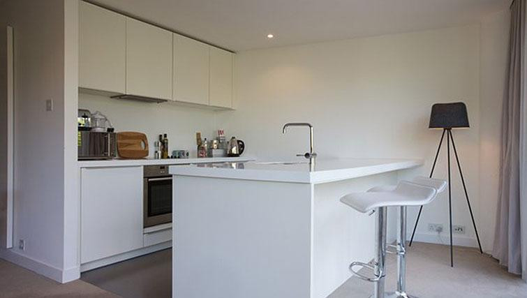 Bright white kitchen with island in the middle