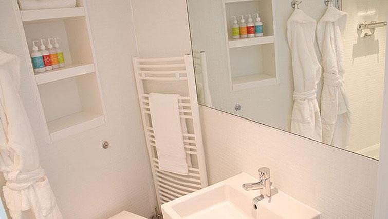 Bright white bathroom in the apartment