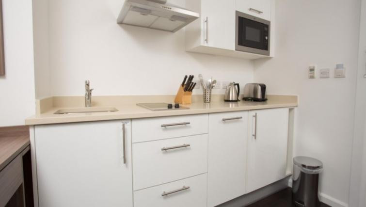 clean cut and white kitchen cabinets
