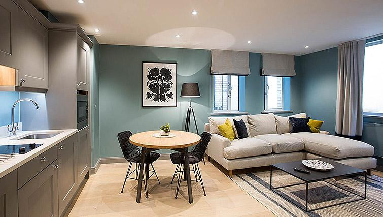 Teal room with grey furnishings