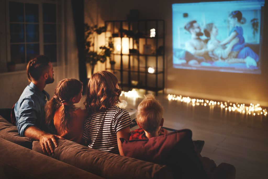 Family watching a film together at home