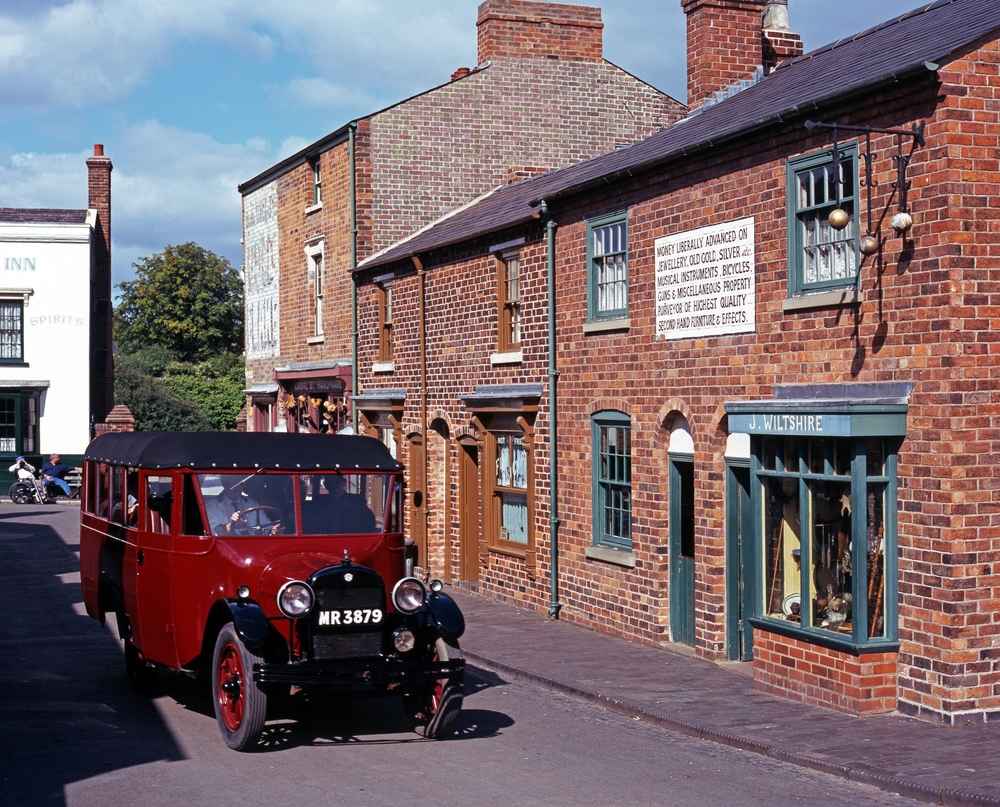 A 1920s bus sat outside Victorian houses at The Black Country Living Musuem.