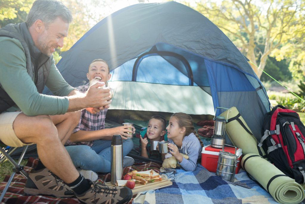 A family outdoors camping