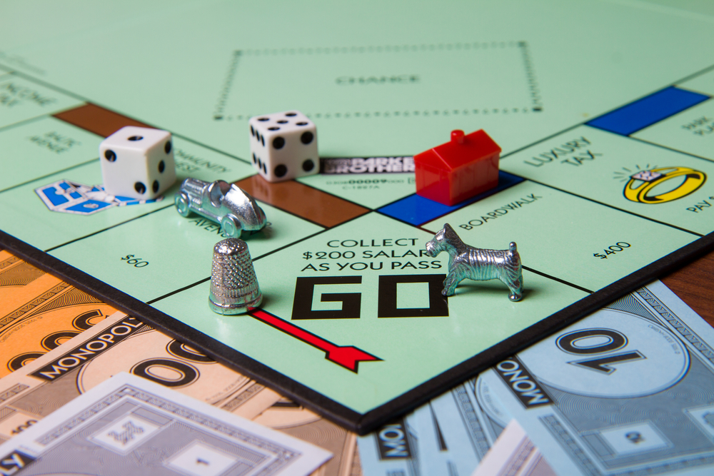 A monopoly board with the Go sign being the main focus.