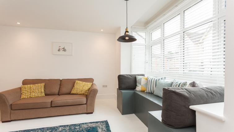 Furnished with cool tones, the living area in Dale House Apartments has a comfy, homely feel