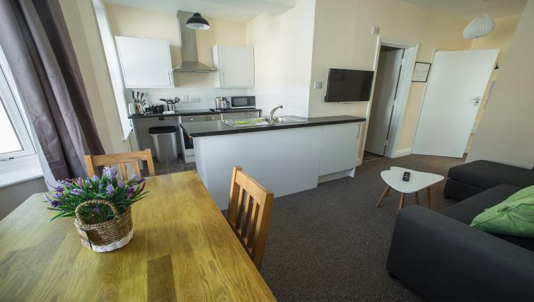 An open plan set up in this Bournemouth serviced apartment allows for a multi-functional living space