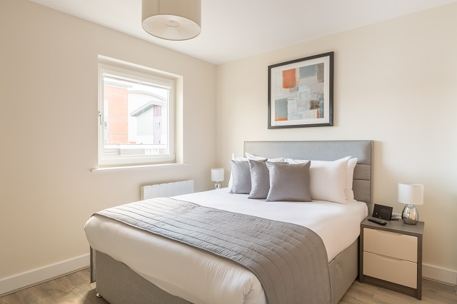 Bright bedroom at Solstice House Apartments - Citybase Apartments