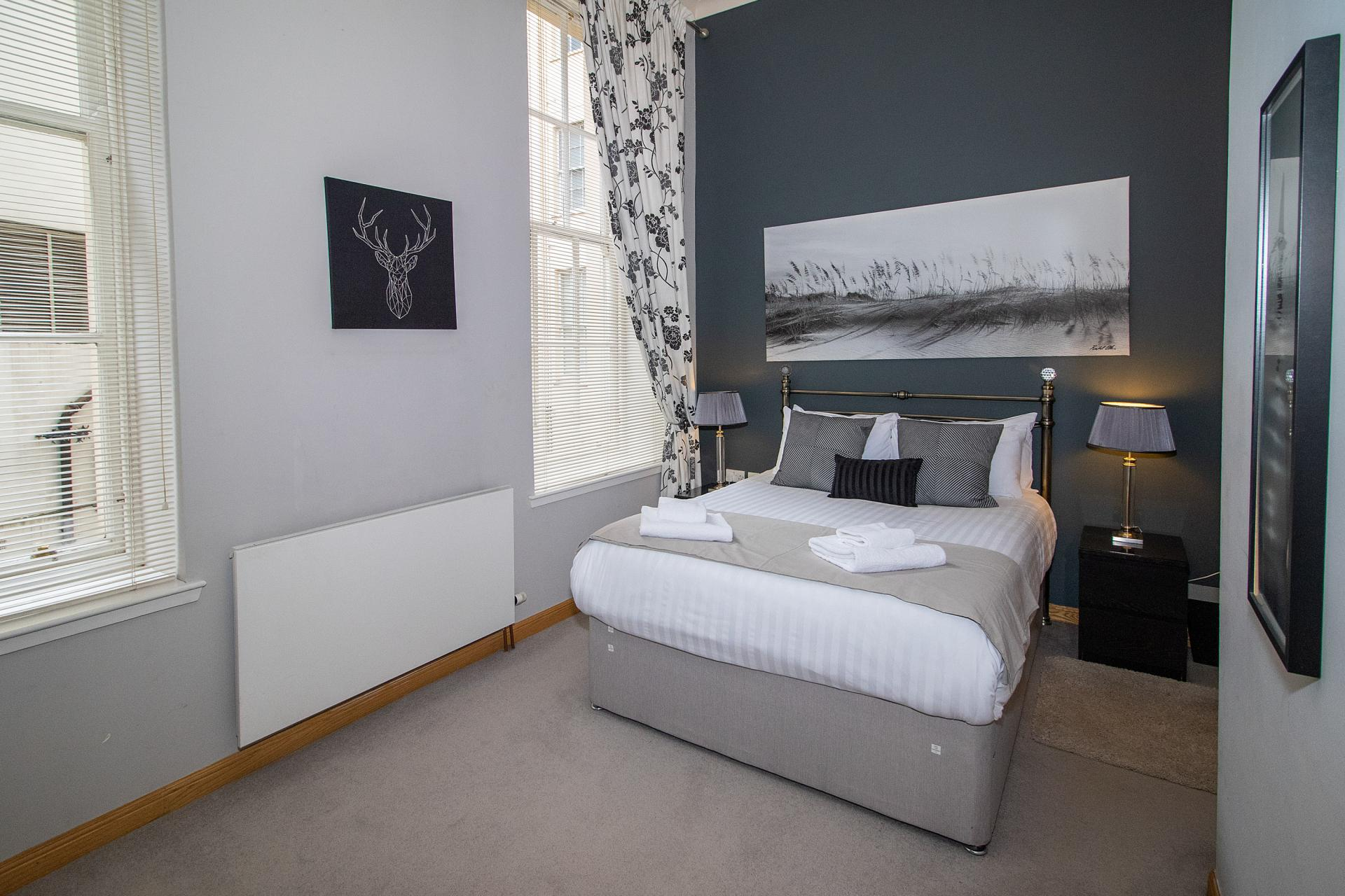 Grey bedroom at College Street Apartment - Citybase Apartments