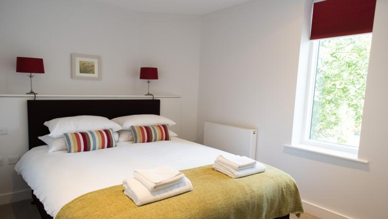 Comfortable bedroom at Jubilee House Apartments - Citybase Apartments