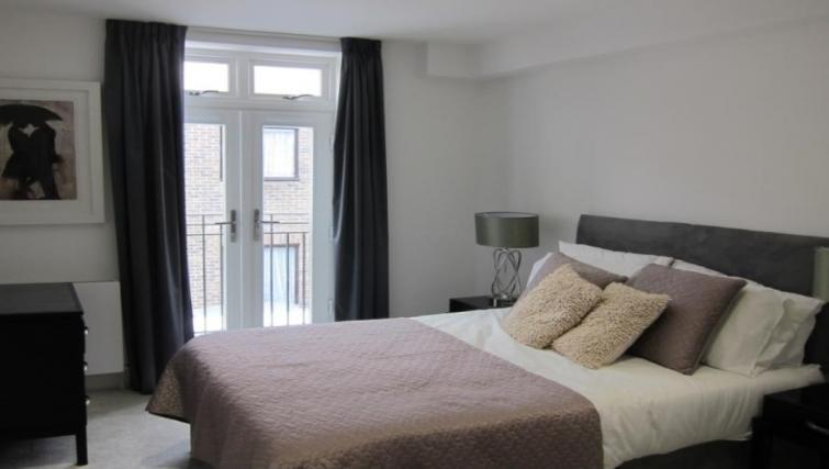 Bright bedroom at Still Life Warren Street Apartment - Citybase Apartments
