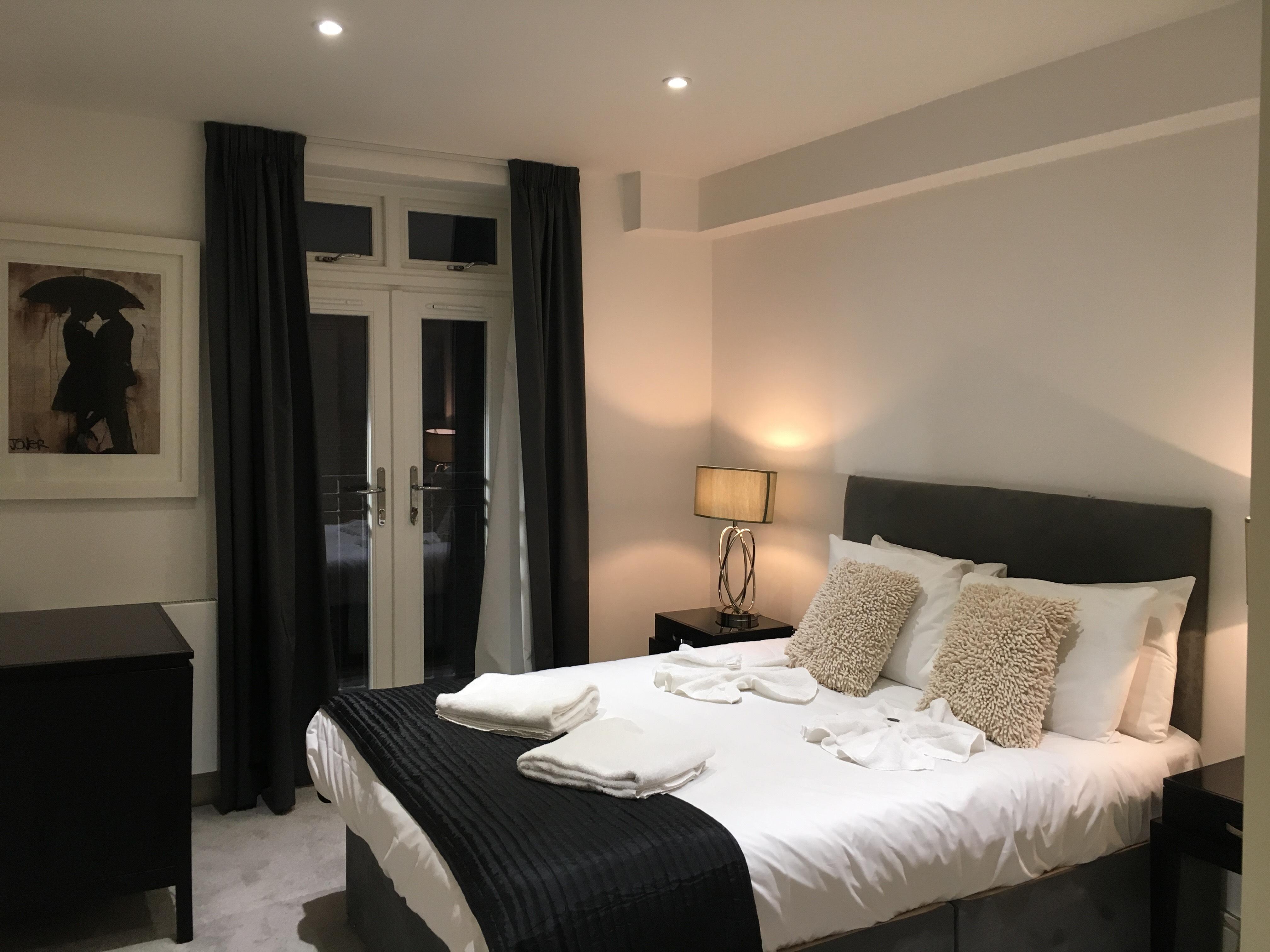 Cosy bedroom at Still Life Warren Street Apartment - Citybase Apartments