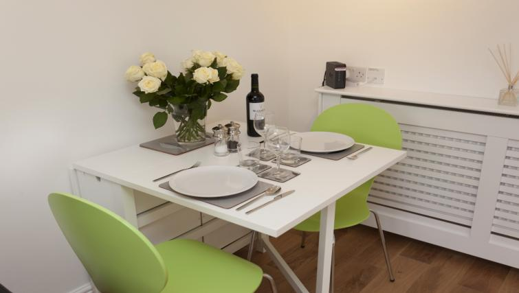 Dining table at Beaver Green Apartment - Citybase Apartments