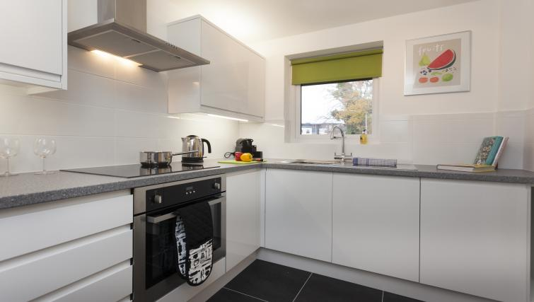 Fully equipped kitchen at Beaver Green Apartment - Citybase Apartments