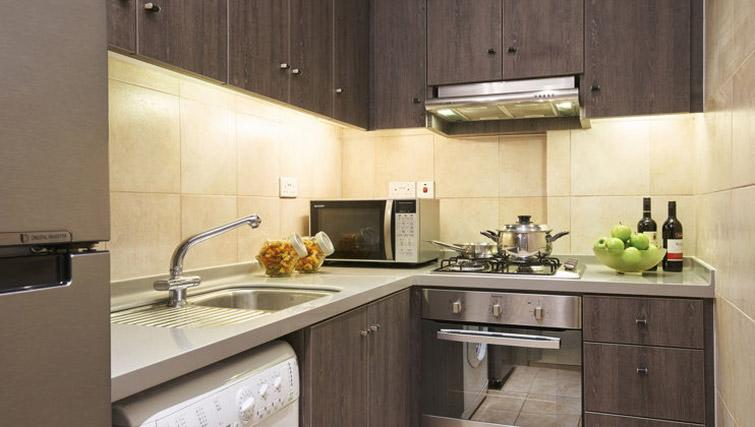 Fully equipped kitchen at Regency House Apartments, Singapore - Citybase Apartments