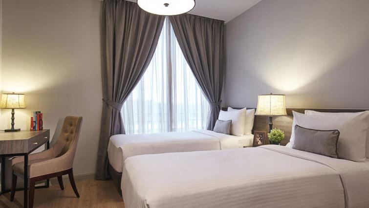 Twin beds at Regency House Apartments, Singapore - Citybase Apartments