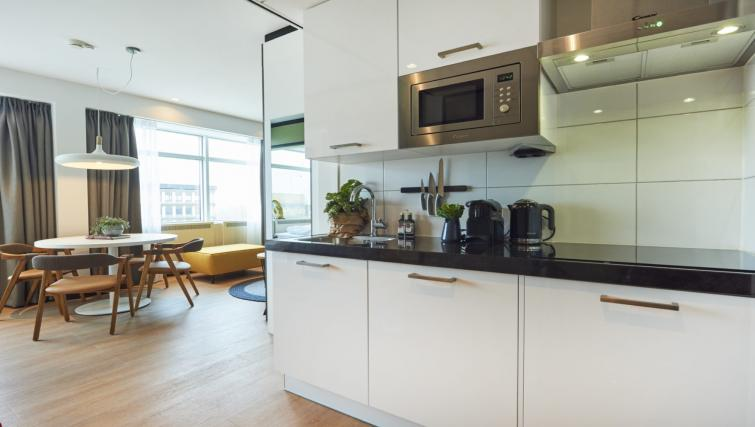 Fully equipped kitchen at Cityden Up Apartments, Amsterdam - Citybase Apartments