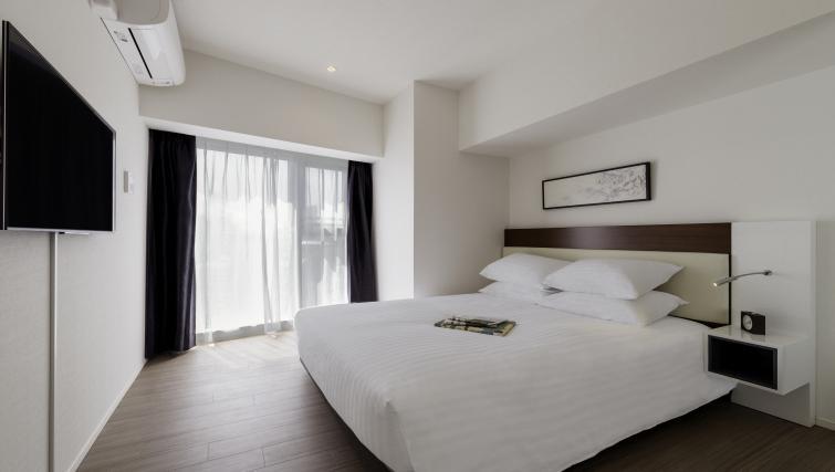 Bedroom at Oakwood Apartments Azabudai - Citybase Apartments