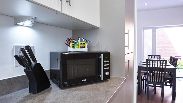 Fully equipped kitchen at Campbell Park Residence - Citybase Apartments