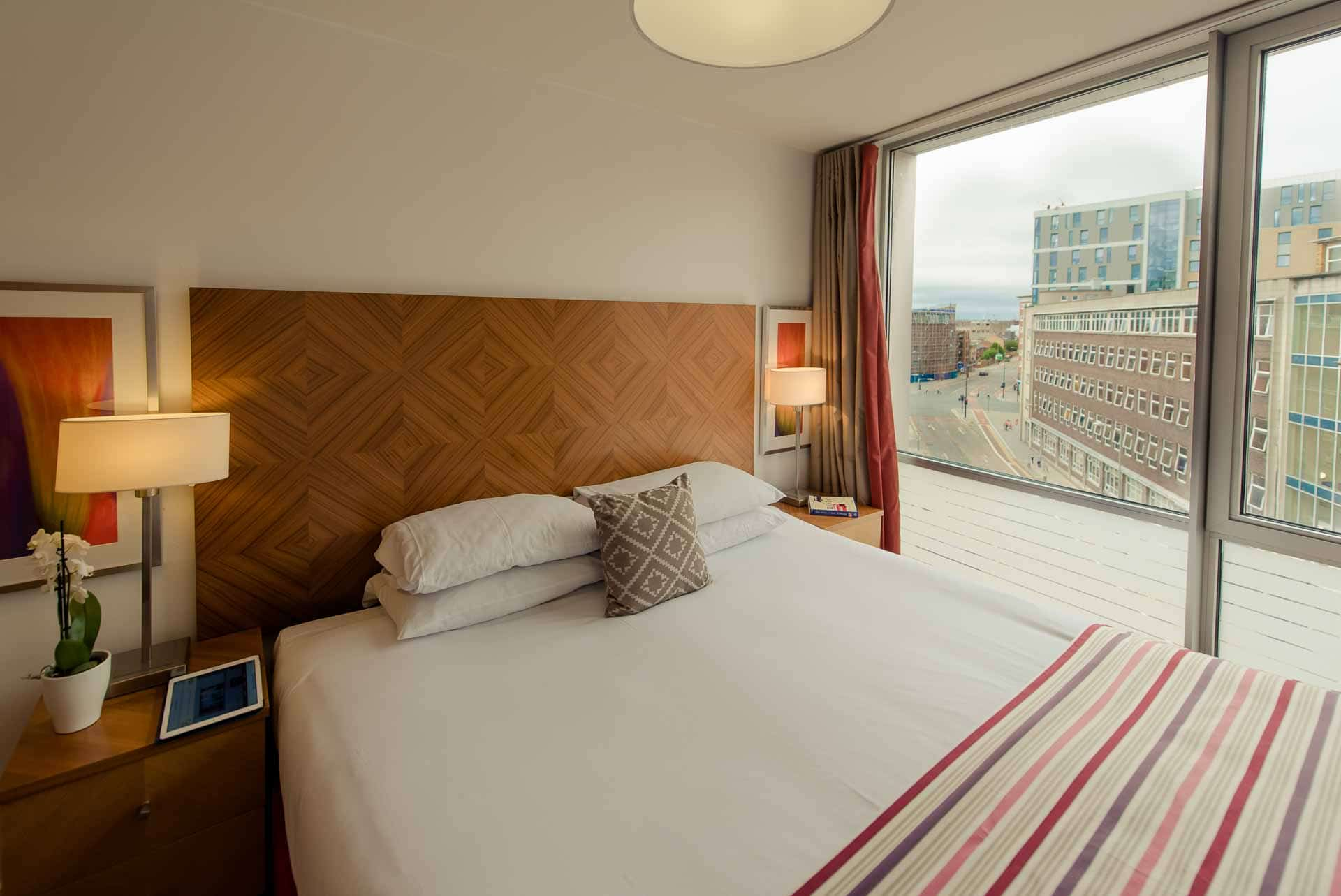 Large windows in bedroom at Premier Suites Liverpool, Centre, Liverpool - Citybase Apartments