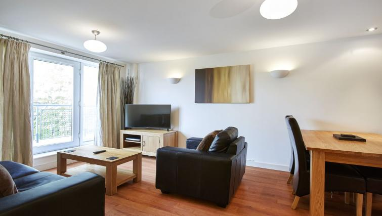 Modern living area at Riverbank Point Apartments - Citybase Apartments