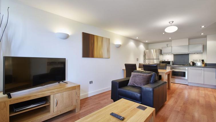 Living room at Riverbank Point Apartments - Citybase Apartments