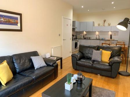 Living room at Principal Ingram Apartment - Citybase Apartments