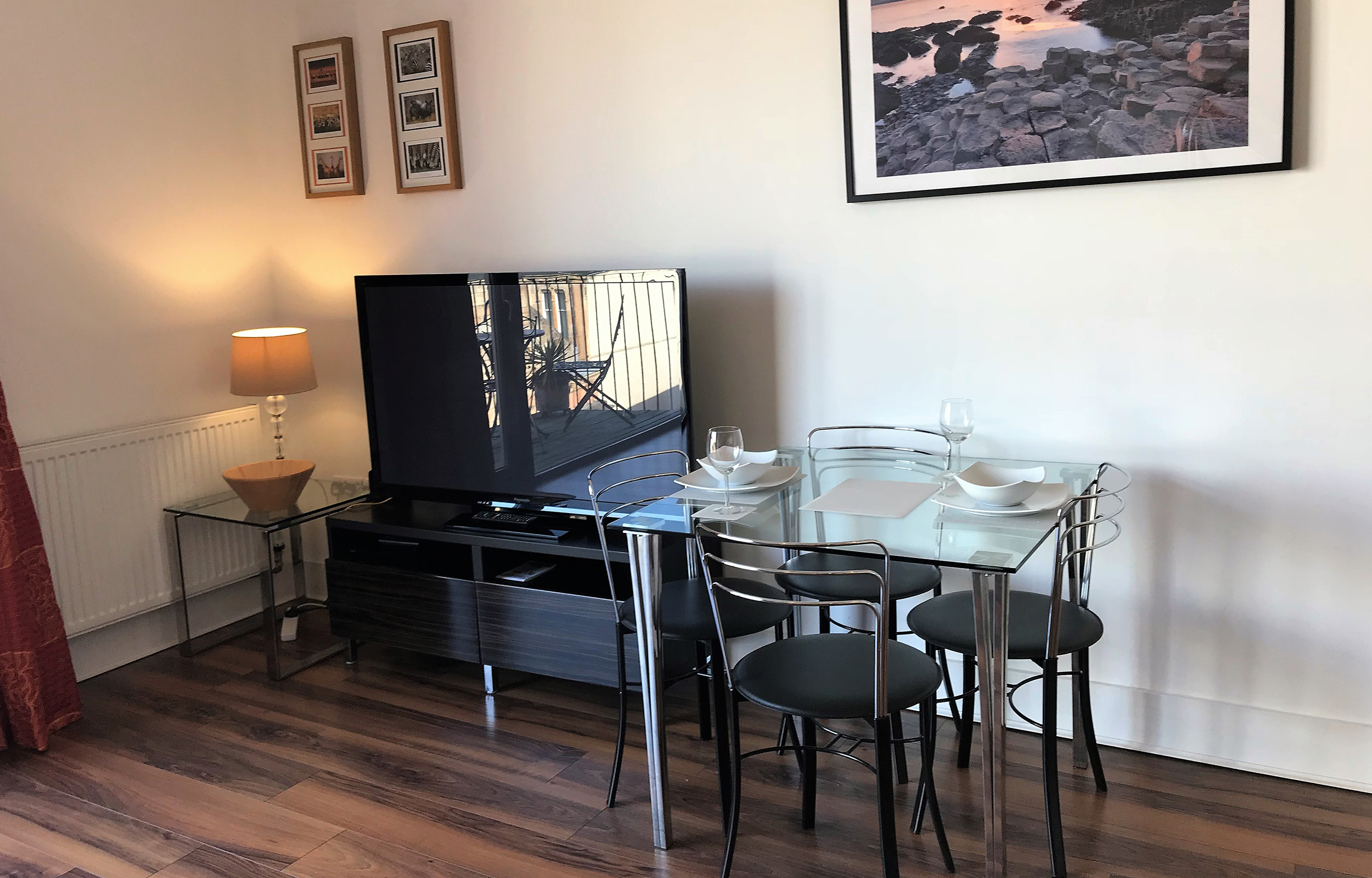 Dining table at Virginia Galleries Apartment - Citybase Apartments
