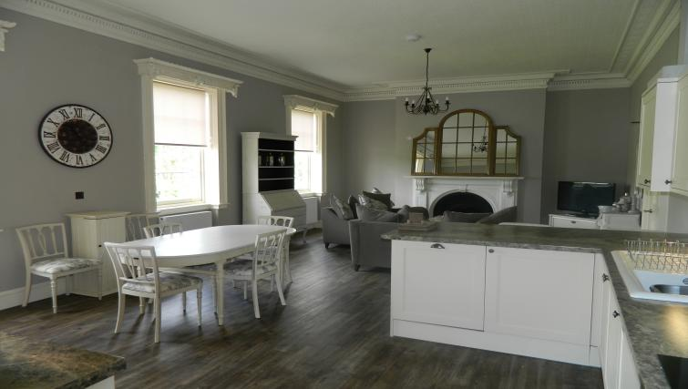 Fully equipped kitchen and dining table at Birchover Bridgford Hall Apartments - Citybase Apartments
