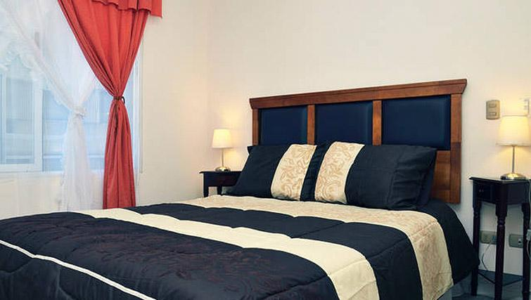 Bed at VIP Apartments Chile - Citybase Apartments
